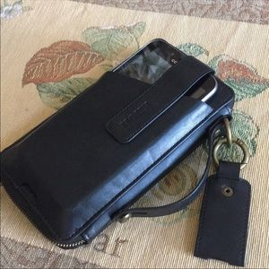 Cell phone holder and wallet wristlet